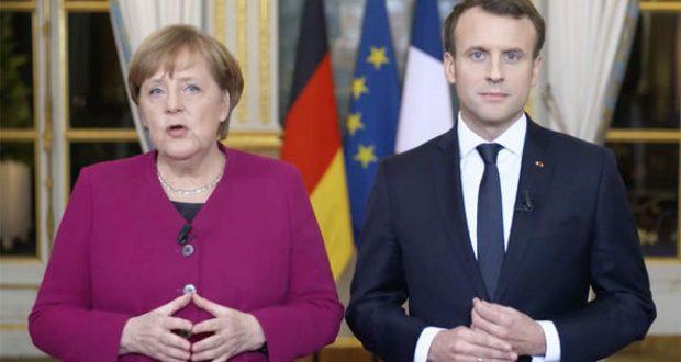 """ميركل تندد بتصريحات إردوغان """"التشهيرية"""" تجاه الرئيس الفرنسي ماكرون"""